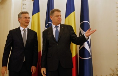 epa05300846 NATO Secretary General Jens Stoltenberg (L) is welcomed by Romania's President Klaus Iohannis at Cotroceni presidential palace in Bucharest, Romania, 12 May 2016. Stoltenberg is in Romania to inaugurate the antimissile defense system Aegis Ashore at the Deveselu military base, part of the US anti-missile shield that will be an integrated part of NATO's anti-ballistic defense system.  EPA/BOGDAN CRISTEL