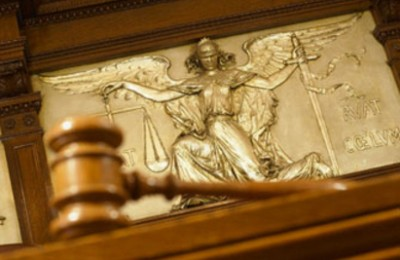 Gavel and Figure of Justice --- Image by © Gaetano/Corbis