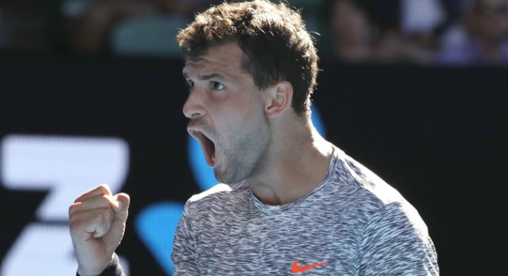 epa05748130 Grigor Dimitrov of Bulgaria reacts with a fist as he wins a game over David Goffin of Belgium during the Men's Singles quarterfinal match at the Australian Open Grand Slam tennis tournament in Melbourne, Victoria, Australia, 25 January 2017.  EPA/MADE NAGI