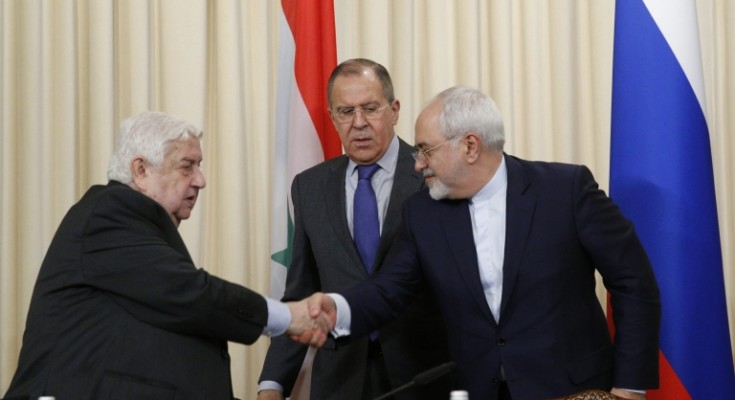 epa05907213 Russian Foreign Minister Sergei Lavrov (C), Syrian Foreign Minister Walid Muallem (L) and Iranian Foreign Minister Mohammad Javada Zarif (R) shake hands after delivering a joint news conference after official talks at the Russian Foreign Ministry guest house in Moscow, Russia, 14 April 2017.  EPA/SERGEI CHIRIKOV