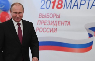 epa06611580 Presidential candidate an current Russian President Vladimir Putin votes at a polling station during presidential elections in Moscow, Russia, 18 March 2018. Eight candidates are contesting for the presidential seat, including the incumbent president Vladimir Putin, who is projected to win his fourth term in the Kremlin.  EPA/YURI KADOBNOV / POOL