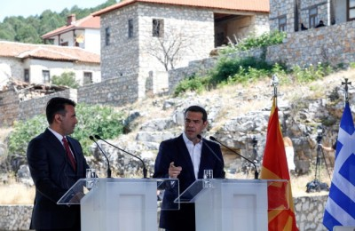 epa06815122 Greek Prime Minister Alexis Tsipras (R) and FYROM Prime Minister Zoran Zaev (L) make statements during a signing ceremony in the village of Psarades, Florina, Greece, 17 June 2018. The foreign ministers of Greece and the Former Yugoslav Republic of Macedonia (FYROM), Nikos Kotzias and Nikola Dimitrov, and the UN Secretary General's Special Envoy for the name dispute signed a historic agreement on 17 June 2018 for resolving the decades-long issue during a lakeside signing ceremony in Prespes, where the borders of Greece, FYROM and Albania meet.  EPA/NIKOS ARVANITIDIS