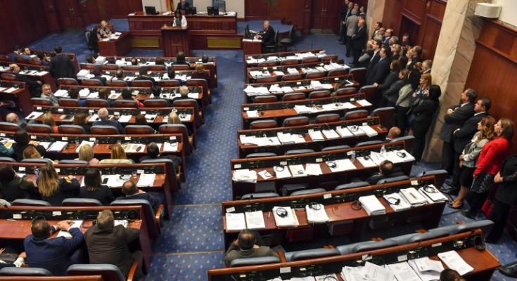 epa07105806 Members of the parliament vote for the start changing the state's constitution as big part of opposition VMRO DPMNE stay from the side on the parliamentary session in Skopje, The Former Yugoslav Republic of Macedonia (FYROM), 19 October 2018. Two thirds (80 members of the parliament) of Macedonian parliament voted to start changing the state's constitution and constitutional changes to change the name of the country in North Macedonia according to the deal with Greece.  EPA/GEORGI LICOVSKI