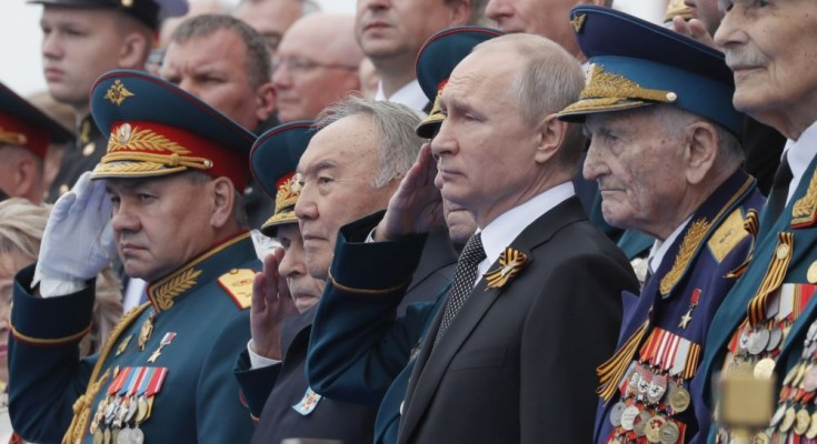 epa07557137 Russian President Vladimir Putin (3-R) and former Kazakh President Nursultan Nazarbayev (C) watch Victory Day parade in Red Square in Moscow, Russia, 09 May 2019. Russia marks 09 May the 74th anniversary of the victory in the World War II over Nazi Germany and its allies. The Soviet Union lost 27 million people in the war.  EPA/YURI KOCHETKOV