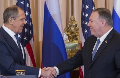 epa08060726 US Secretary of State Mike Pompeo (R) shakes hands with Russian Foreign Minister Sergey Lavrov (L) after a press conference at the Department of State in Washington, DC, USA, 10 December 2019. Lavrov is scheduled to meet with US President Donald J. Trump at the White House later in the day.  EPA/ERIK S. LESSER