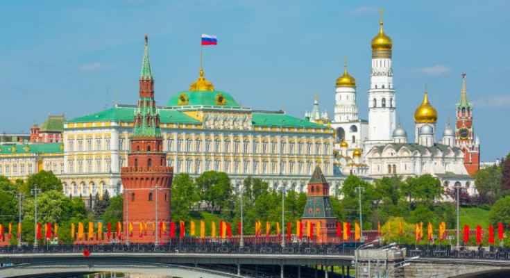 View of Moscow Kremlin behind the Bolshoy Kamenny Bridge with bright flags