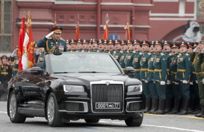 epa07557113 Russian Defense Minister Sergei Shoigu salutes participants from a new limousine Aurus during Victory Day parade in Red Square in Moscow, Russia, 09 May 2019. Russia marks 09 May the 74th anniversary of the victory in the World War II over Nazi Germany and its allies. The Soviet Union lost 27 million people in the war.  EPA/YURI KOCHETKOV