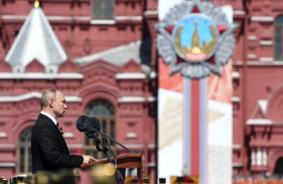 epa08505291 Russian President and Commander-in-Chief of the Russian Armed Forces Vladimir Putin delivers a speech during a military parade, marking the 75th anniversary of the Nazi defeat, in Moscow, Russia, 24 June 2020. The Victory Day military parade normally is held on 09 May, the nation's most important secular holiday, but this year it was postponed due to the coronavirus pandemic.  EPA/SERGEY PYATAKOV / POOL MANDATORY CREDIT: HOST PHOTO AGENCY