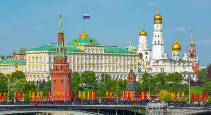 View of Moscow Kremlin behind the Bolshoy Kamenny Bridge with bright flags