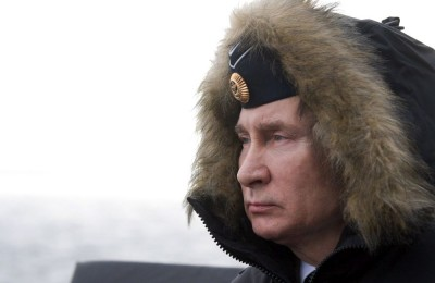 epa08114498 Russian President and Armed Forces Supreme Commander-in-Chief Vladimir Putin on board of the Russian Northern fleet's Marshal Ustinov missile cruiser watches the joint drills of the Northern and Black sea fleets in the Black Sea, Crimea, 09 January 2020. The exercise included Kalibr cruise missiles and Kinzhal hypersonic aero-ballistic ballistic missiles firing.  EPA/ALEXEI DRUZHININ / SPUTNIK / KREMLIN POOL MANDATORY CREDIT
