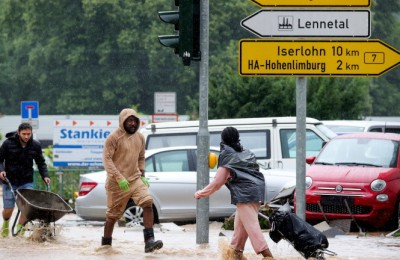 epa09343834 Heavy rain flooded numerous streets and basements of residential houses in Hagen, Germany, 14 July 2021. Large parts of North Rhine-Westphalia were hit by heavy, continuous rain on Tuesday evening. According to the German Weather Service (DWD), the rain is not expected to let up until 15 July. The Rhine level has risen significantly in recent days.  EPA/FRIEDEMANN VOGEL
