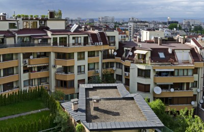 Sofia, Bulgaria - May 12, 2019: Green gardens with a place for recreation in a new residential neighborhood of the Bulgarian capital Sofia, Bulgaria. Visit in place.